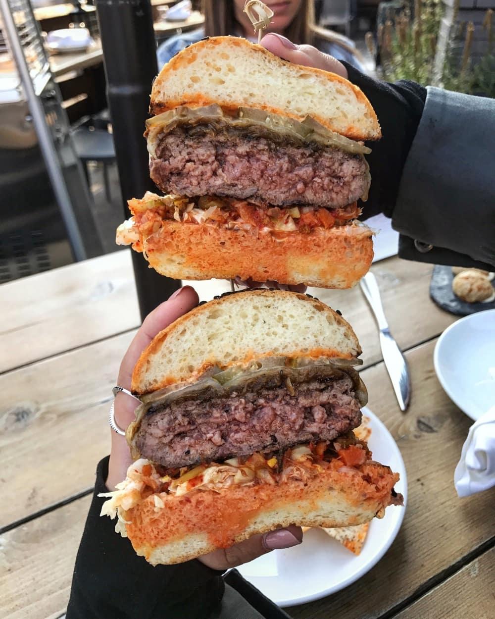 Rasa Burger: beef cheek, provolone, gochujang mayo, pickles, scrapchi, taro chips in Toronto.